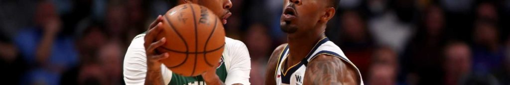 Will Barton #5 of the Denver Nuggets defends Sterling Brown #23 of the Milwaukee Bucks at Pepsi Center