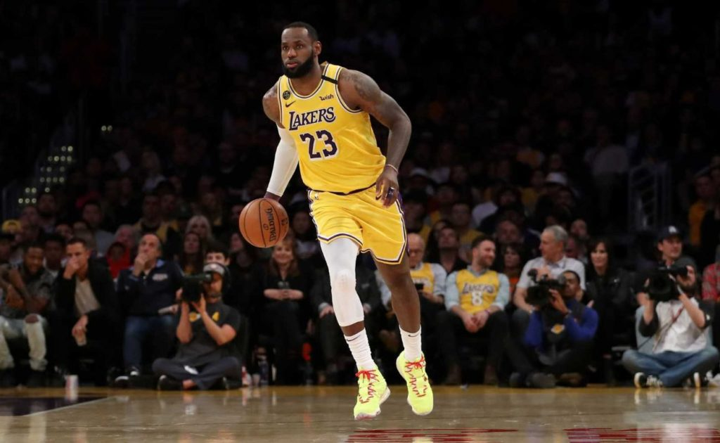 LeBron James #23 of the Los Angeles Lakers dribbles down the court in a game against the Philadelphia 76ers