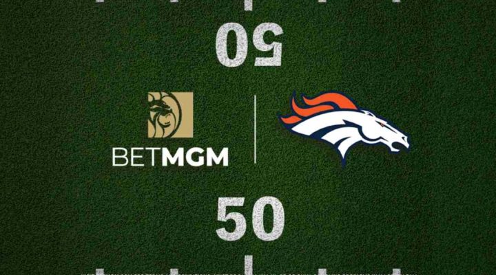 Football field with the Broncos logo and BetMGM on either side of the halfway line.