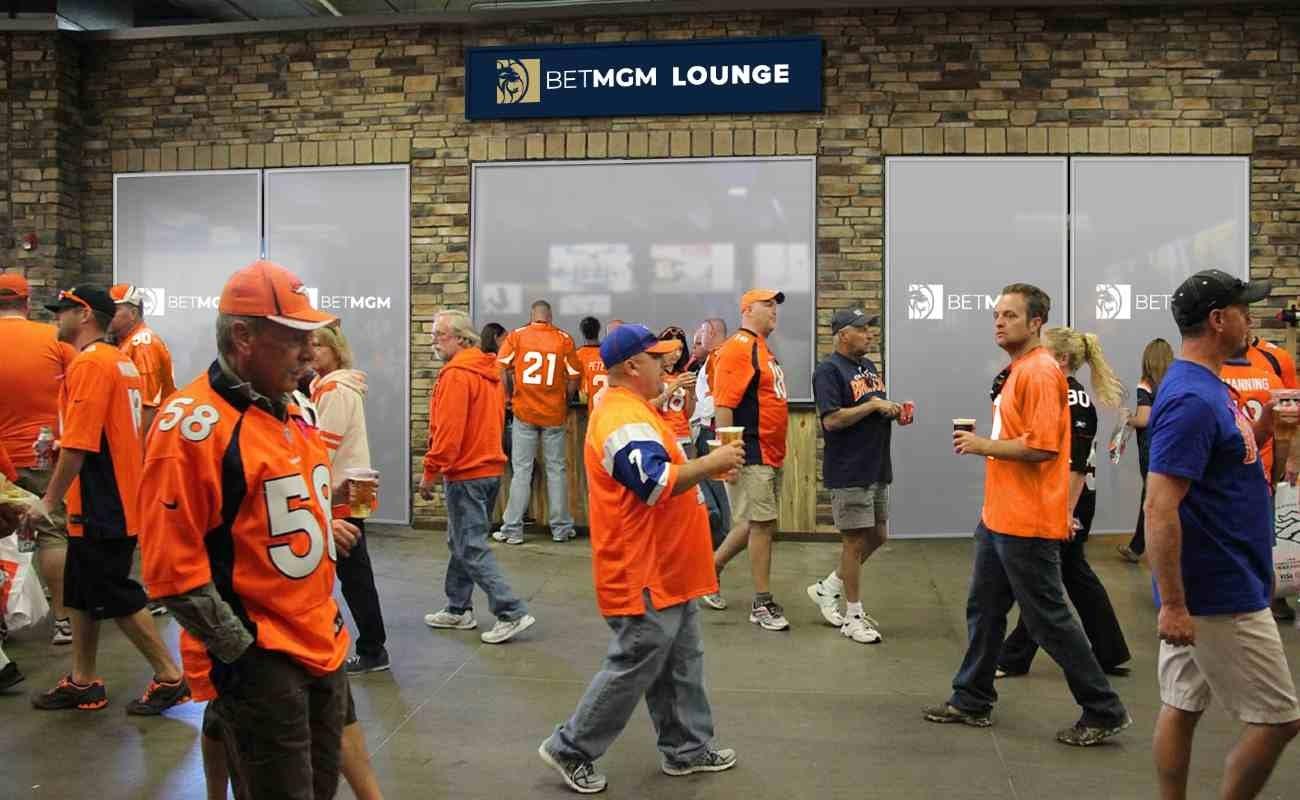 Denver Broncos fans walking past the BetMGM lounge at Empower Field at Mile High Stadium.