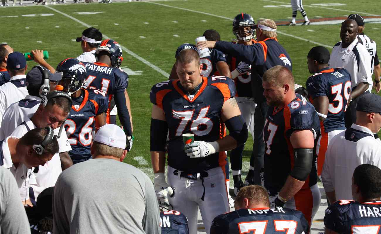 Denver Broncos players and technical team at training camp