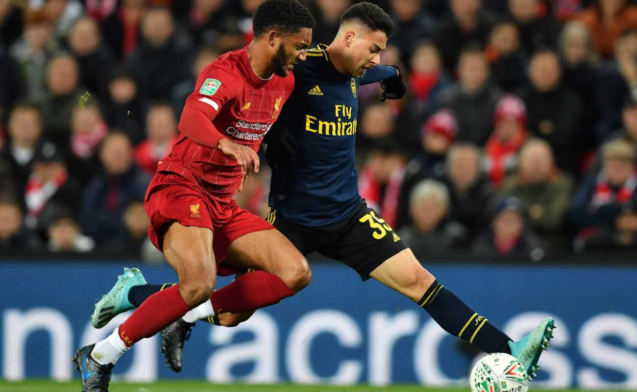 Liverpool defender, Joe Gomez, goes in to tackle Arsenal strike Gabriel Martinelli who has the ball