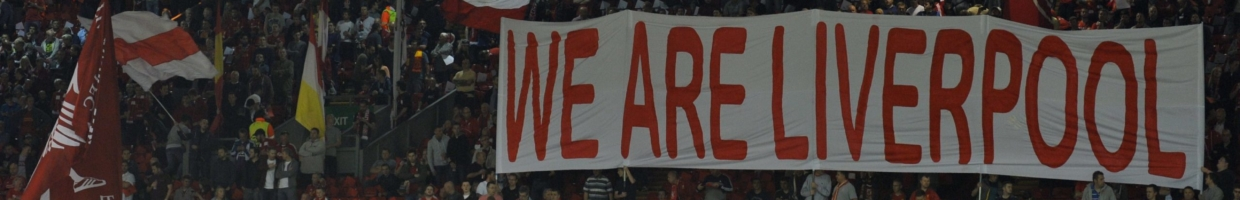 """Fans hold up a """"We Are Liverpool"""" sign during a game at Anfield"""