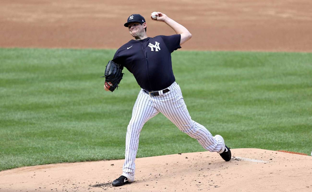 Jordan Montgomery of New York Yankees pitches during summer workouts at Yankee Stadium