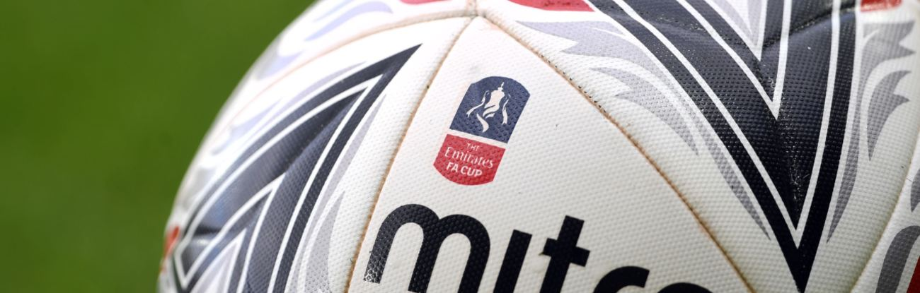 Match ball on the pitch showing the FA Cup logo