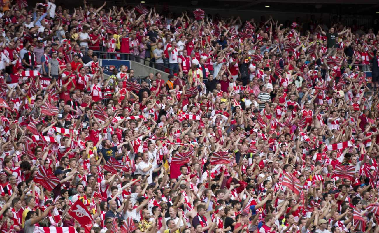 Arsenal fans celebrate their victory against Chelsea FC in the FA Cup final at Wembley Stadium on May 27, 2017