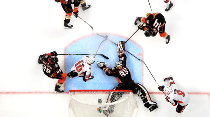 Top view of the Ottawa Senators playing the Anaheim Ducks.