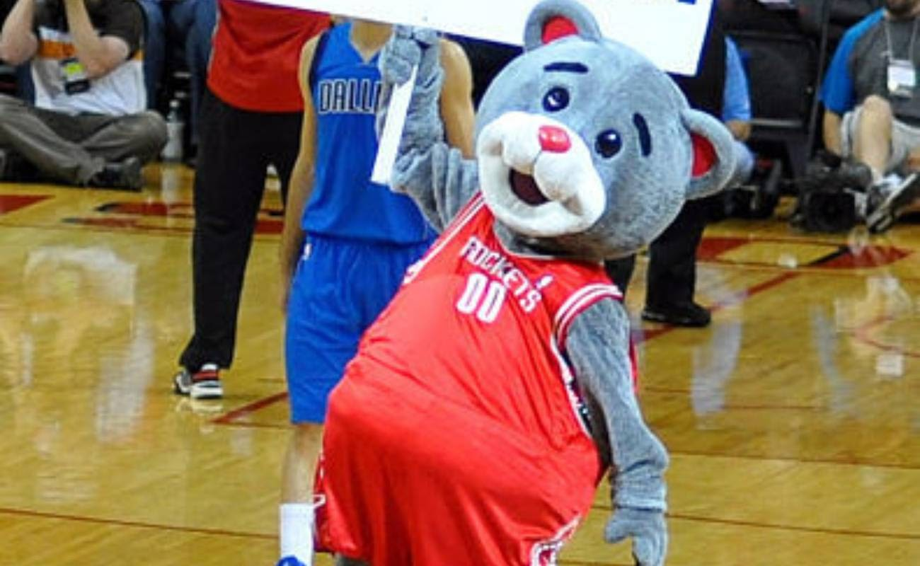 Houston Rockets mascot Clutch the Bear entertains the crowd prior to an NBA basketball game