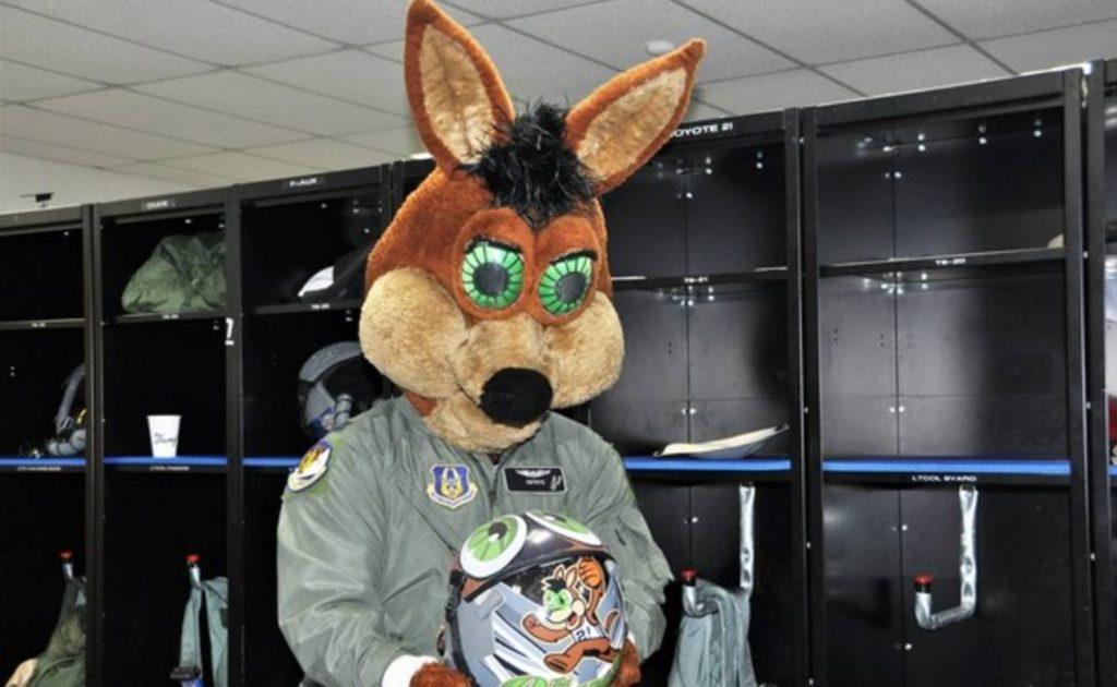 San Antonio Spurs team mascot The Coyote  holding mascot helmet in locker room