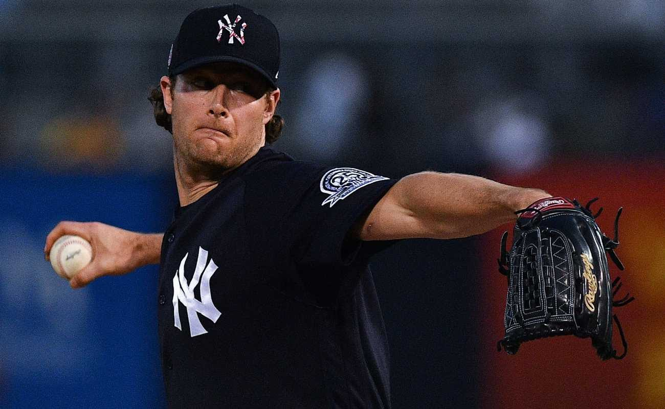 Gerrit Cole #45 of the New York Yankees delivers a pitch during spring training game against Pittsburgh Pirates