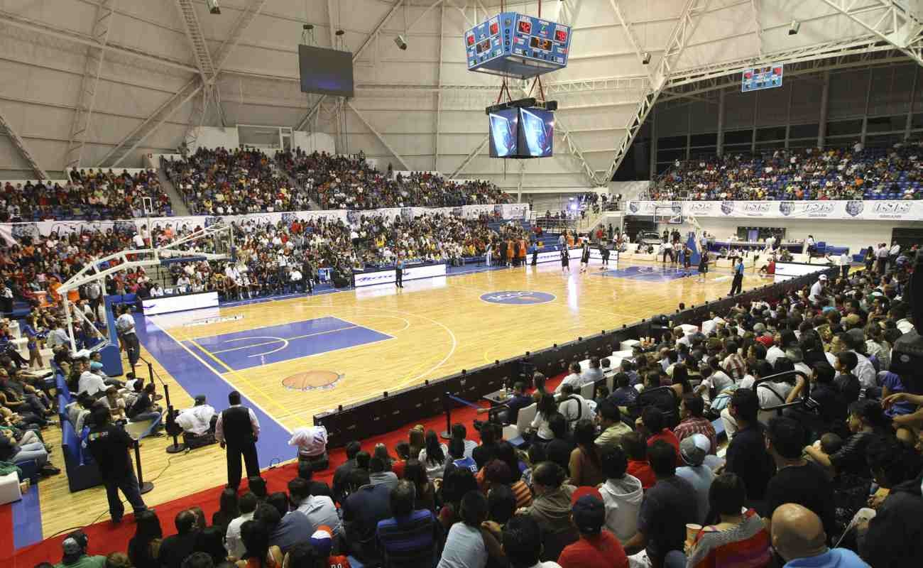Basketball court with fans ready to watch game.