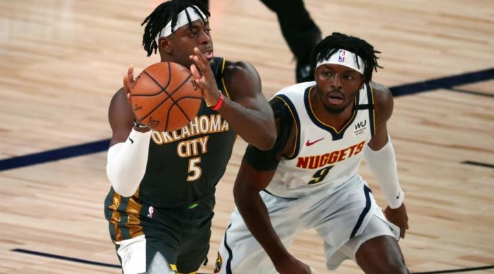 Luguentz Dort of Oklahoma City Thunder passes the ball against Jerami Grant of Denver Nuggets at ESPN Wide World Of Sports Complex on August 3 2020