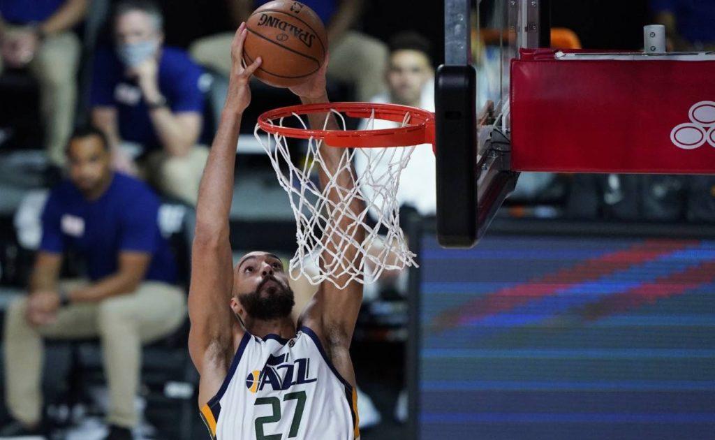 Rudy Gobert of Utah Jazz dunks against Oklahoma City Thunder during NBA basketball game on August 1 2020