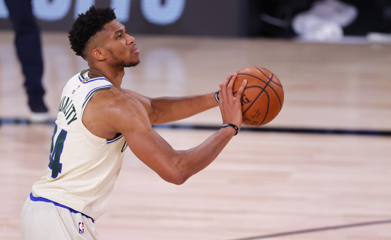 Giannis Antetokounmpo of Milwaukee Bucks shoots a free throw at The Arena at ESPN Wide World Of Sports Complex in August 2020