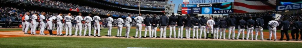 Yankees players lined up on the field