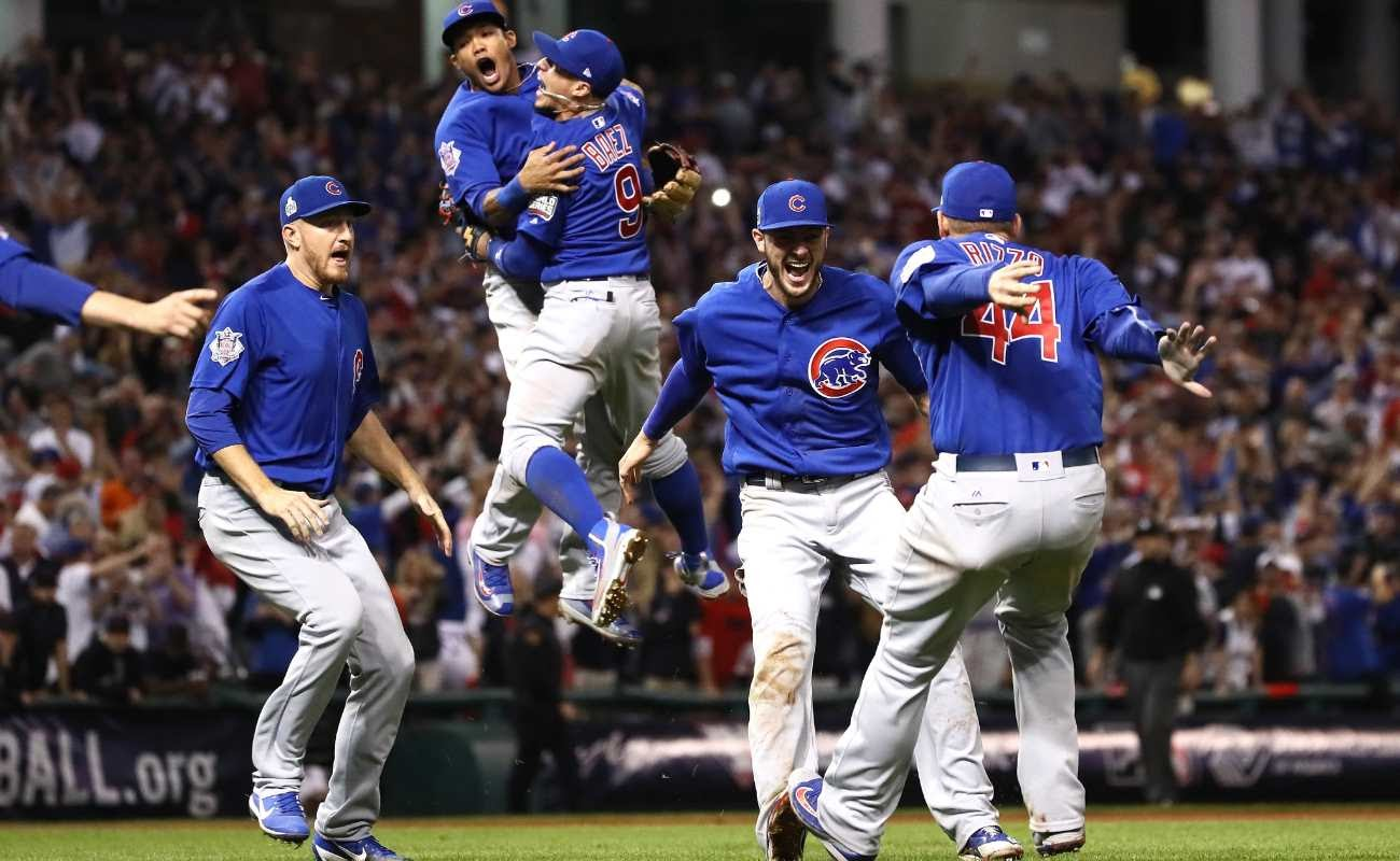 Chicago Cubs team celebrates on the field.