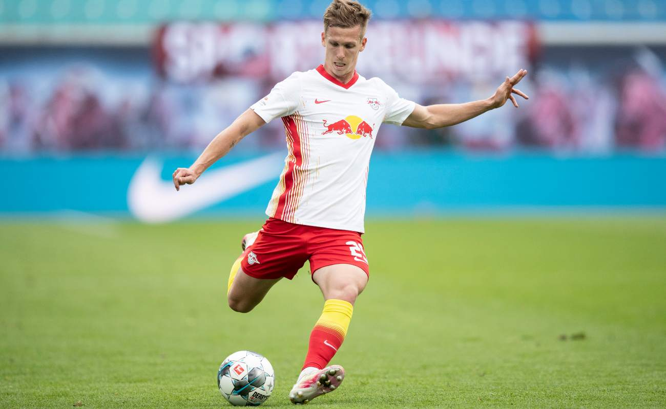 Dani Olmo of RB Leipzig striking the ball