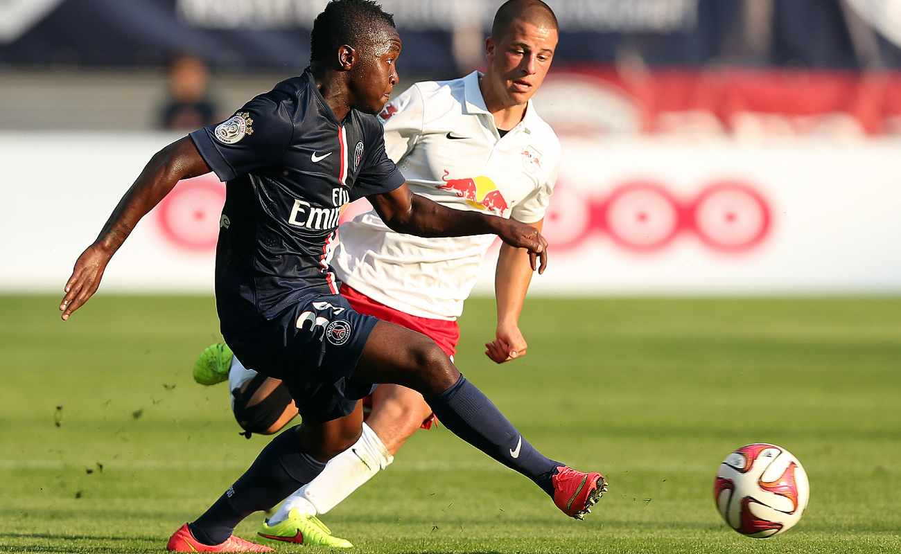 PSG striker Hervin Ongenda passes around Diego Demme of RB Leipzig in a friendly match in 2014