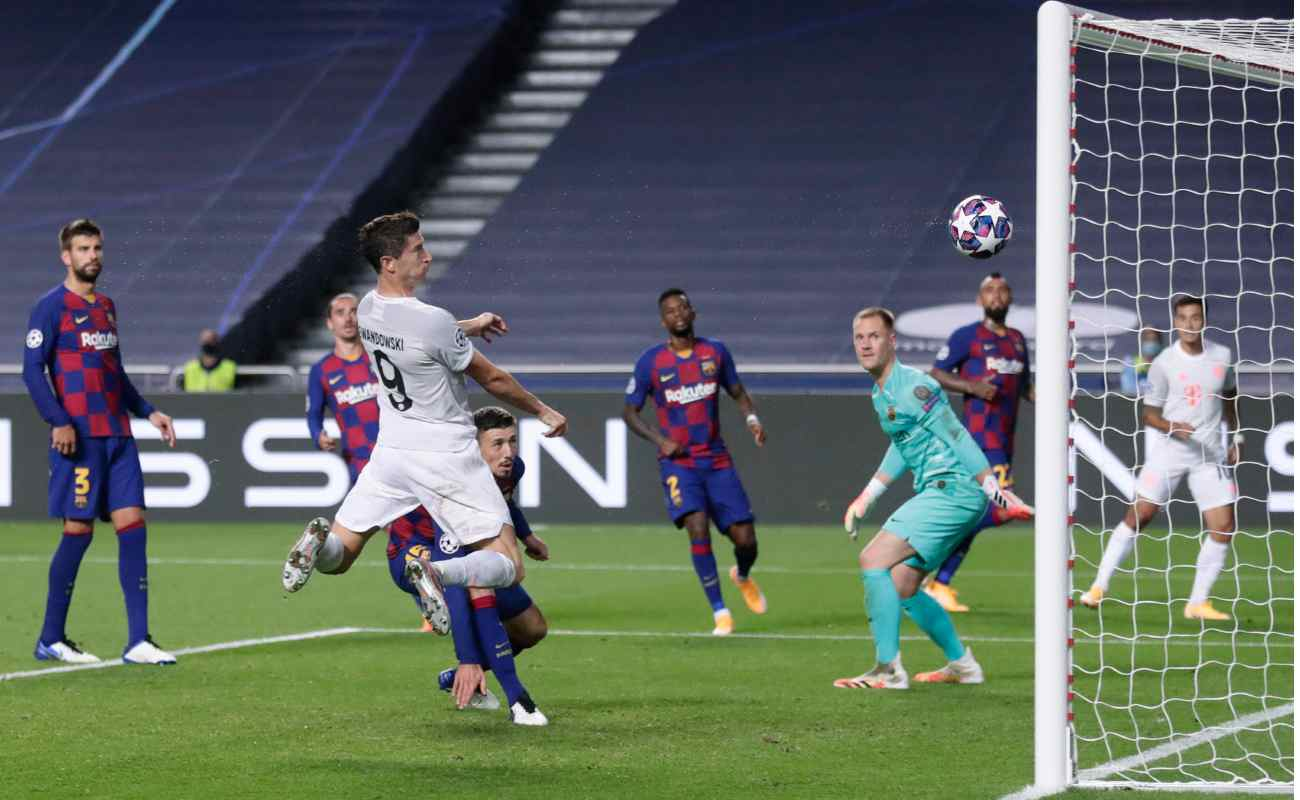 Robert Lewandowski heads the ball into the goal against Barcelona in the UEFA Champions League quarter-finals