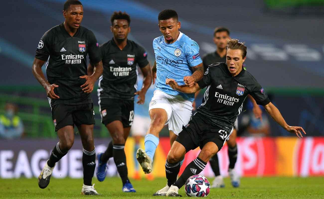 Maxence Caqueret of Lyon tackles Manchester City's Gabriel Jesus