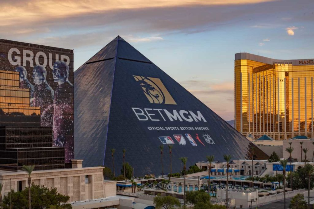The new BetMGM ad wrap on the Luxor hotel at dusk.