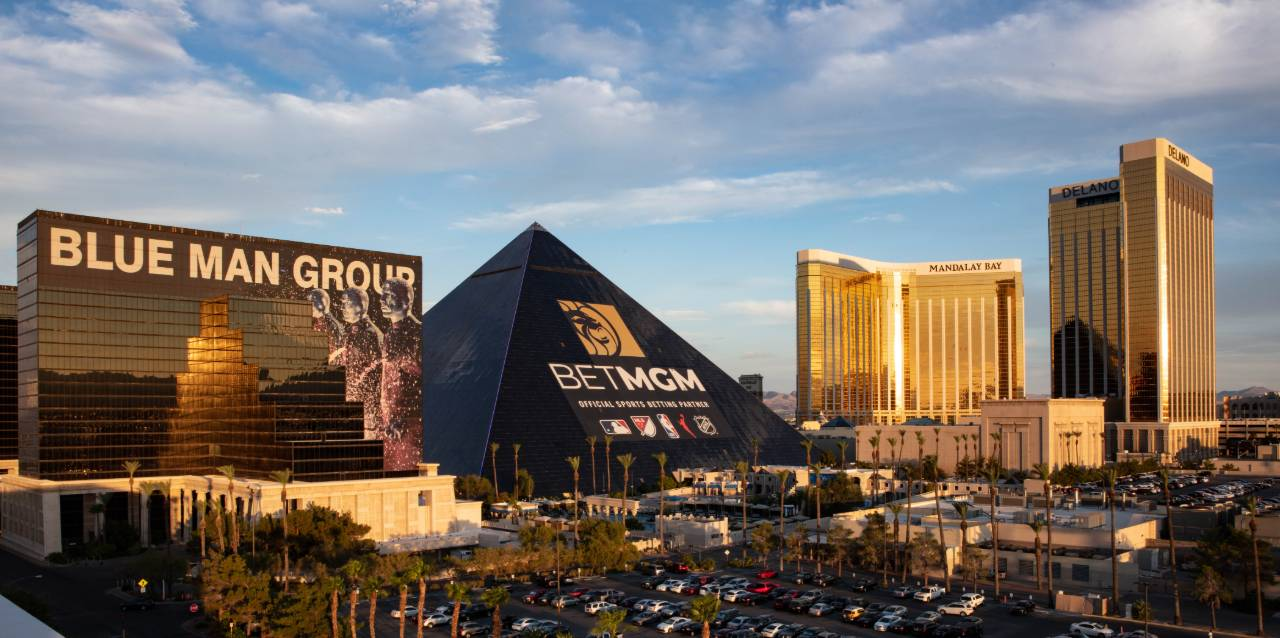 The Luxor hotel with the new BetMGM ad wrap and surrounding hotels.