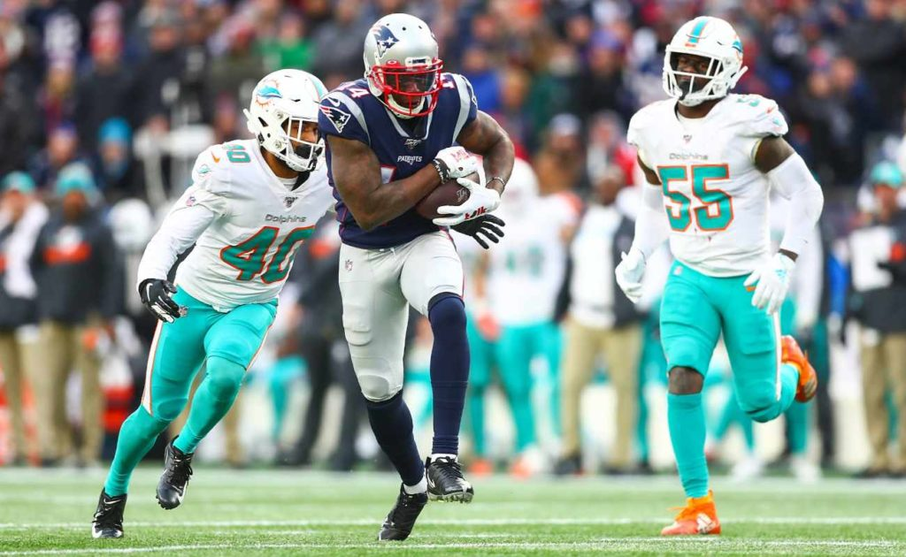 Mohamed Sanu of New England Patriots runs ball during game against Miami Dolphins