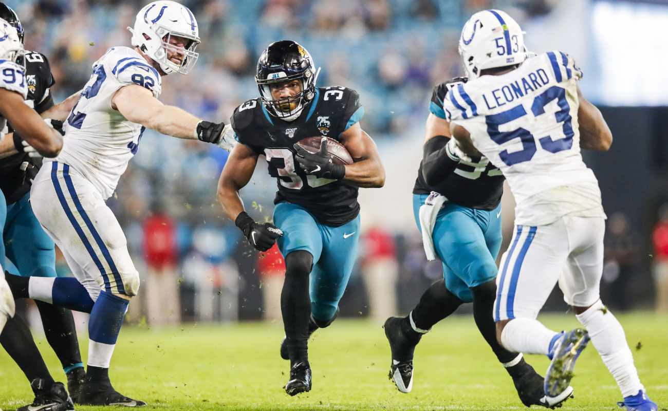 Devine Ozigbo of Jacksonville Jaguars runs for yardage against Indianapolis Colts during game at TIAA Bank Field