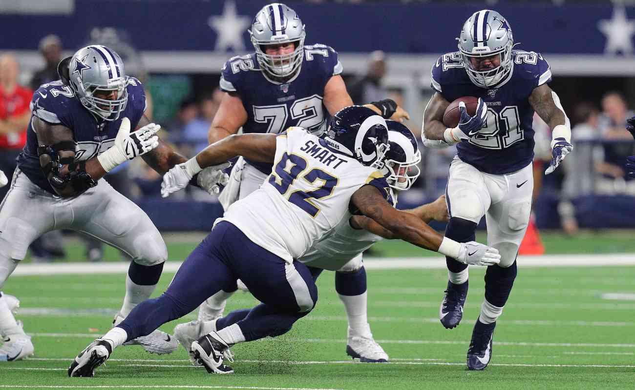 Tanzel Smart of Los Angeles Rams against Ezekiel Elliott of Dallas Cowboys at AT&T Stadium