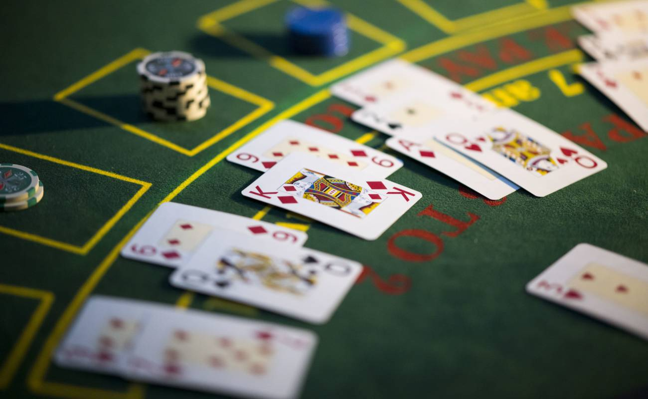 Close-up of playing cards on a roulette table