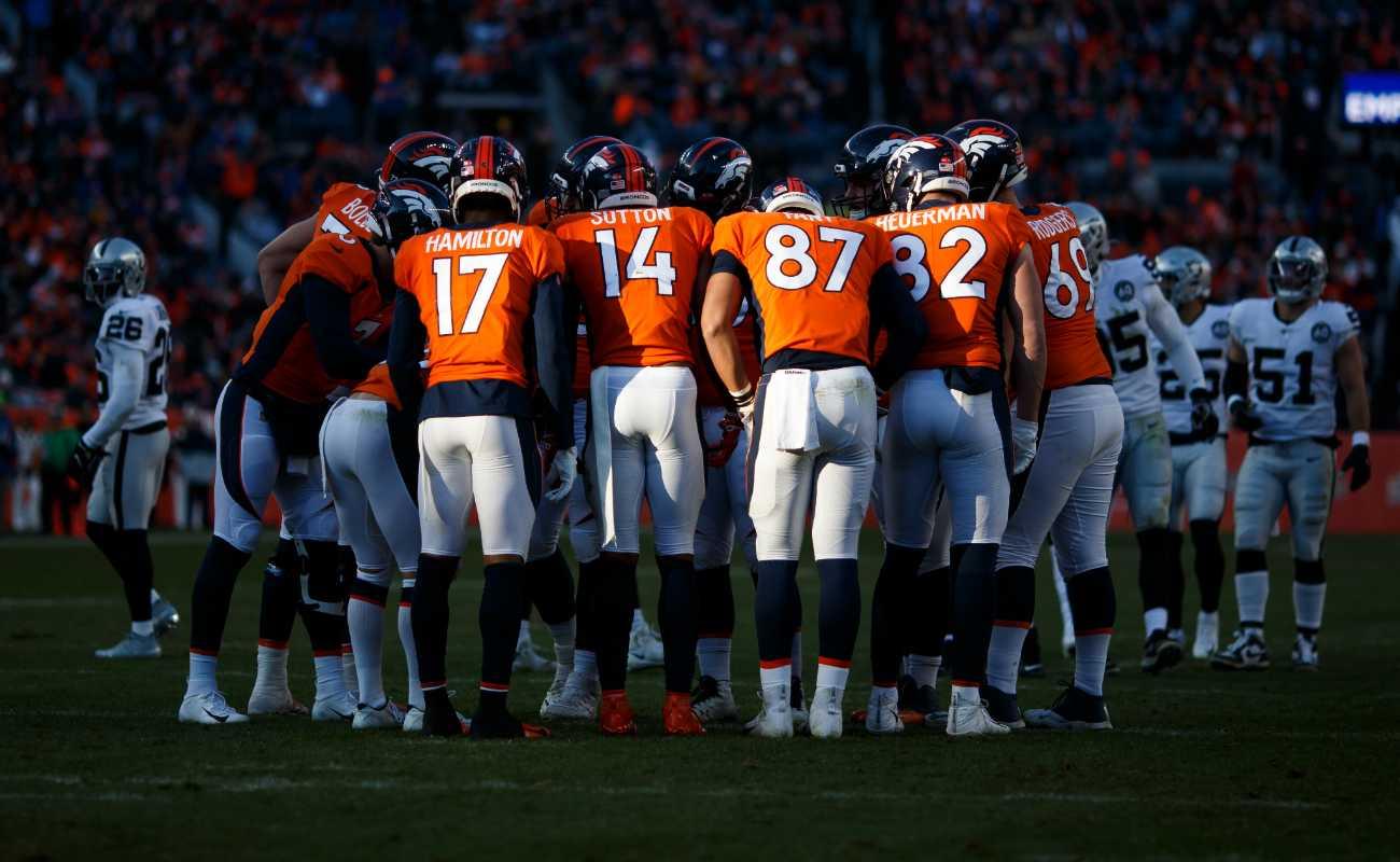 Denver Broncos huddle against Oakland Raiders during game at Empower Field on December 29, 2019