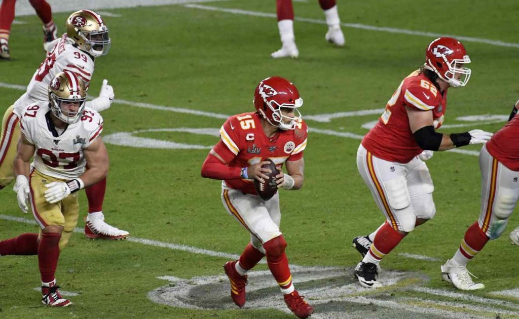 Patrick Mahomes #15 of the Kansas City Chiefs scrambles away from the pressure against the San Francisco 49ers in Super Bowl LIV at Hard Rock Stadium on February 02, 2020
