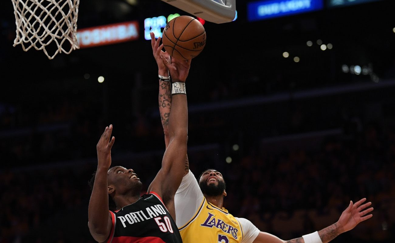 Anthony Davis ofLos Angeles Lakers and Caleb Swanigan of Portland Trail Blazers on January 31, 2020