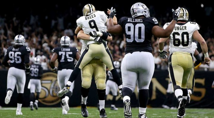 Drew Brees #9 of the New Orleans Saints celebrates with Zach Strief after throwing a 98 yard touchdown pass during the third quarter against the Raiders