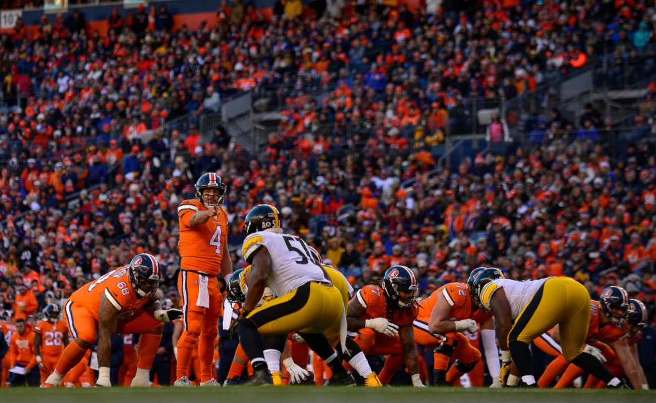Quarterback Case Keenum #4 of the Denver Broncos runs the offense against the Pittsburgh Steelers at Broncos Stadium at Mile High on November 25, 2018