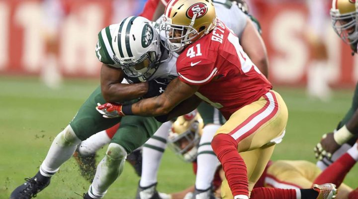 Bilal Powell of the New York Jets gets tackled by Antoine Bethea of the San Francisco 49ers