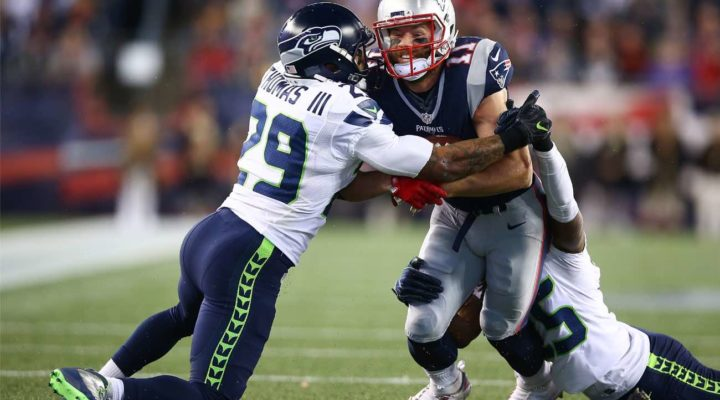 Julian Edelman of New England Patriots tackled by Earl Thomas of Seattle Seahawks at Gillette Stadium November 2016