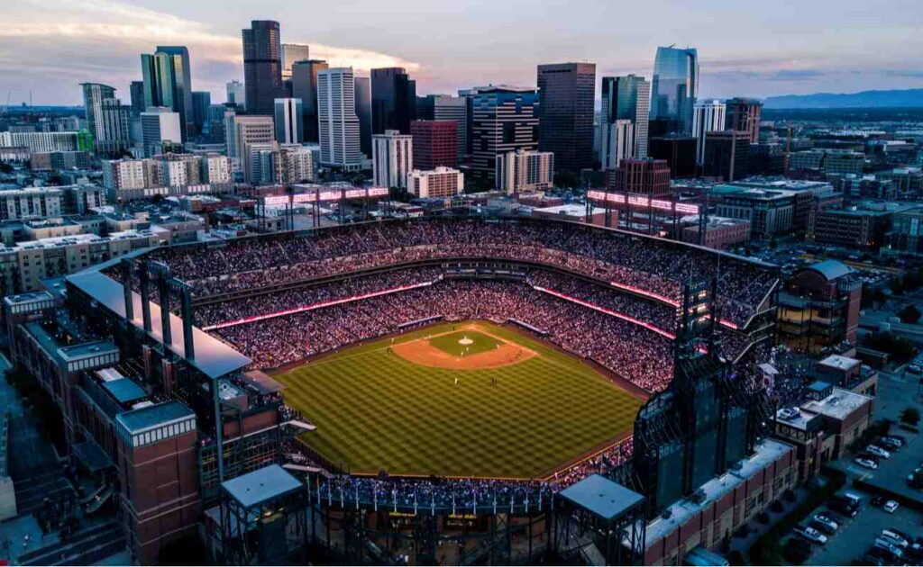 Aerial drone photo of Denver Colorado skyline at sunset