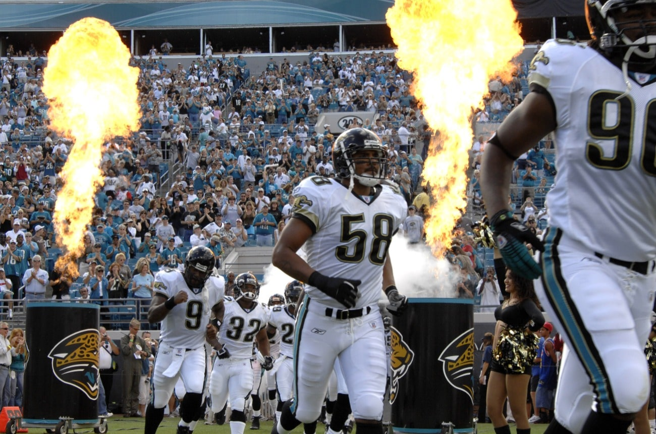 Jacksonville Jaguars dash to the field amid fire and smoke before play against the New York Jets on Ocober 8, 2006 in Jacksonville, Florida.