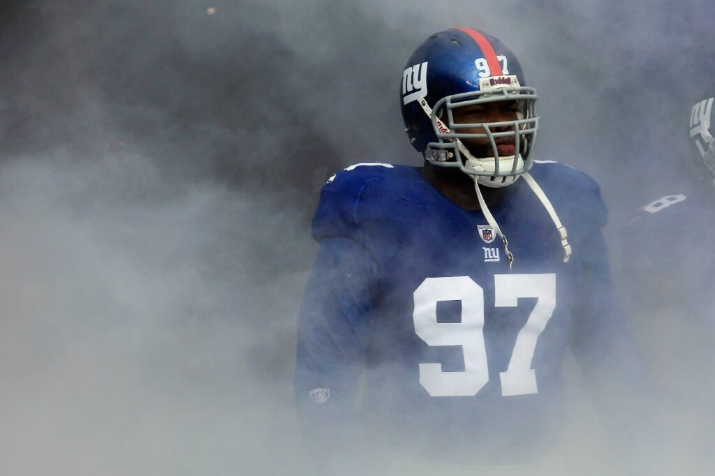 Smoke fills the tunnel as Linval Joseph #97 of the New York Giants waits to take the field during player introductions against the Atlanta Falcons during their NFC Wild Card Playoff game at MetLife Stadium on January 8, 2012 in East Rutherford, New Jersey.