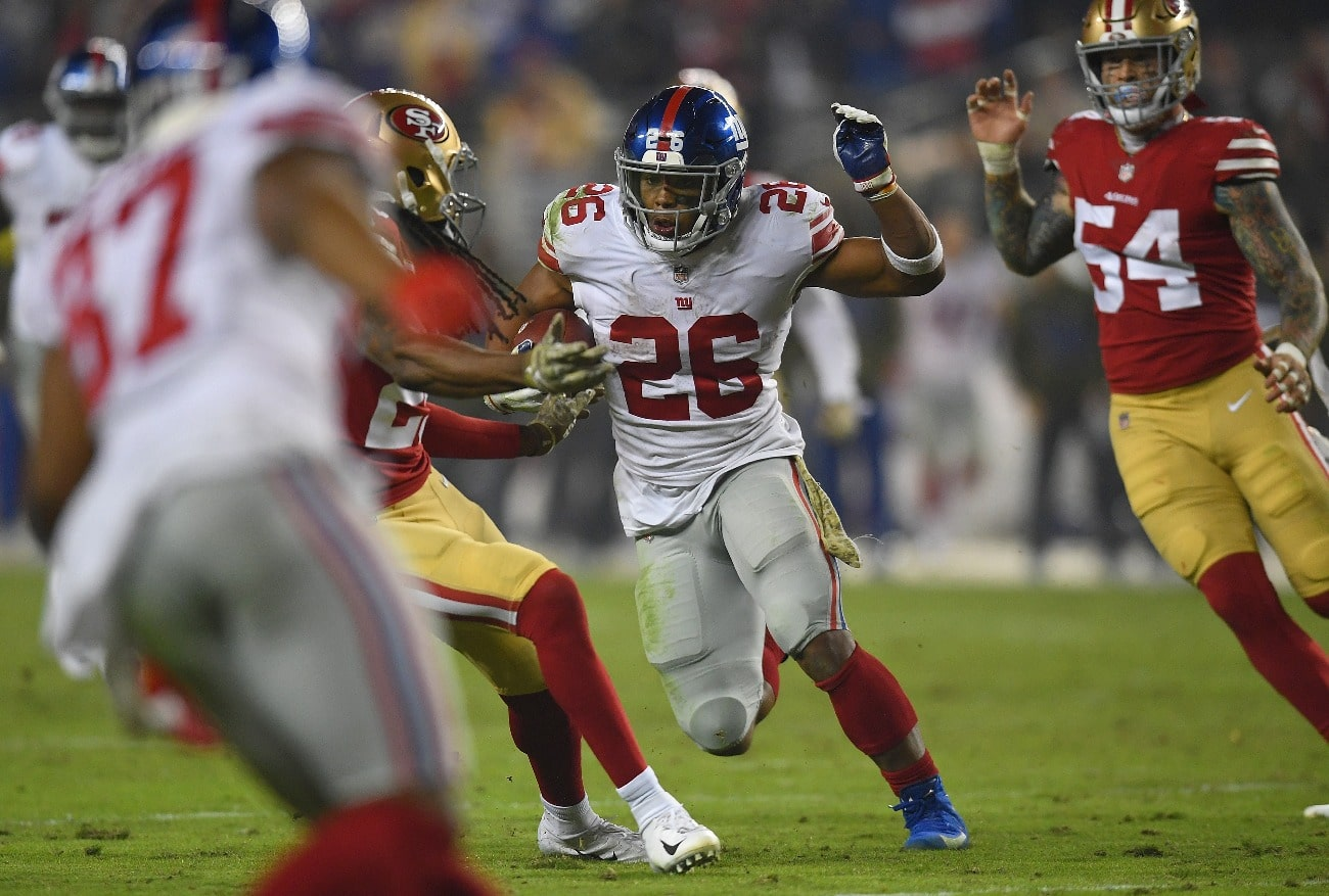 Saquon Barkley #26 of the New York Giants carries the ball against the San Francisco 49ers during the second half of their NFL football game at Levi's Stadium on November 12, 2018 in Santa Clara, California.