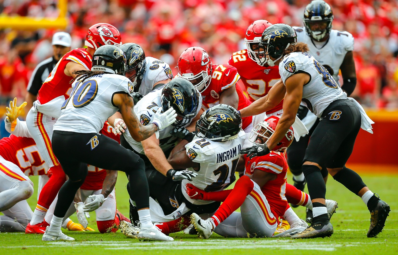 Mark Ingram #21 of the Baltimore Ravens lunges for extra yards while being tackled by Kendall Fuller #29 of the Kansas City Chiefs at Arrowhead Stadium on September 22, 2019 in Kansas City, Missouri