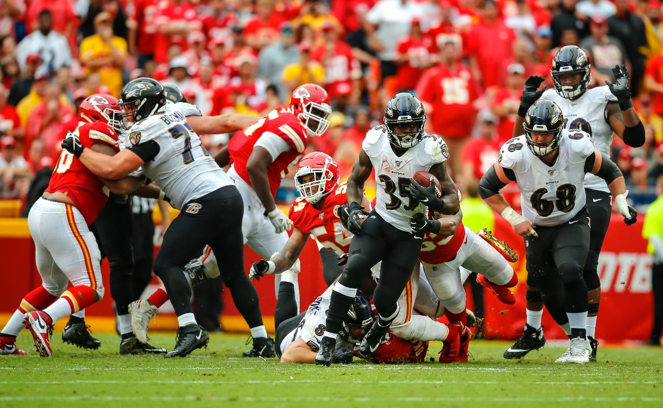 Gus Edwards #35 of the Baltimore Ravens runs for yardage against the Kansas City Chiefs at Arrowhead Stadium on September 22, 2019 in Kansas City, Missouri.