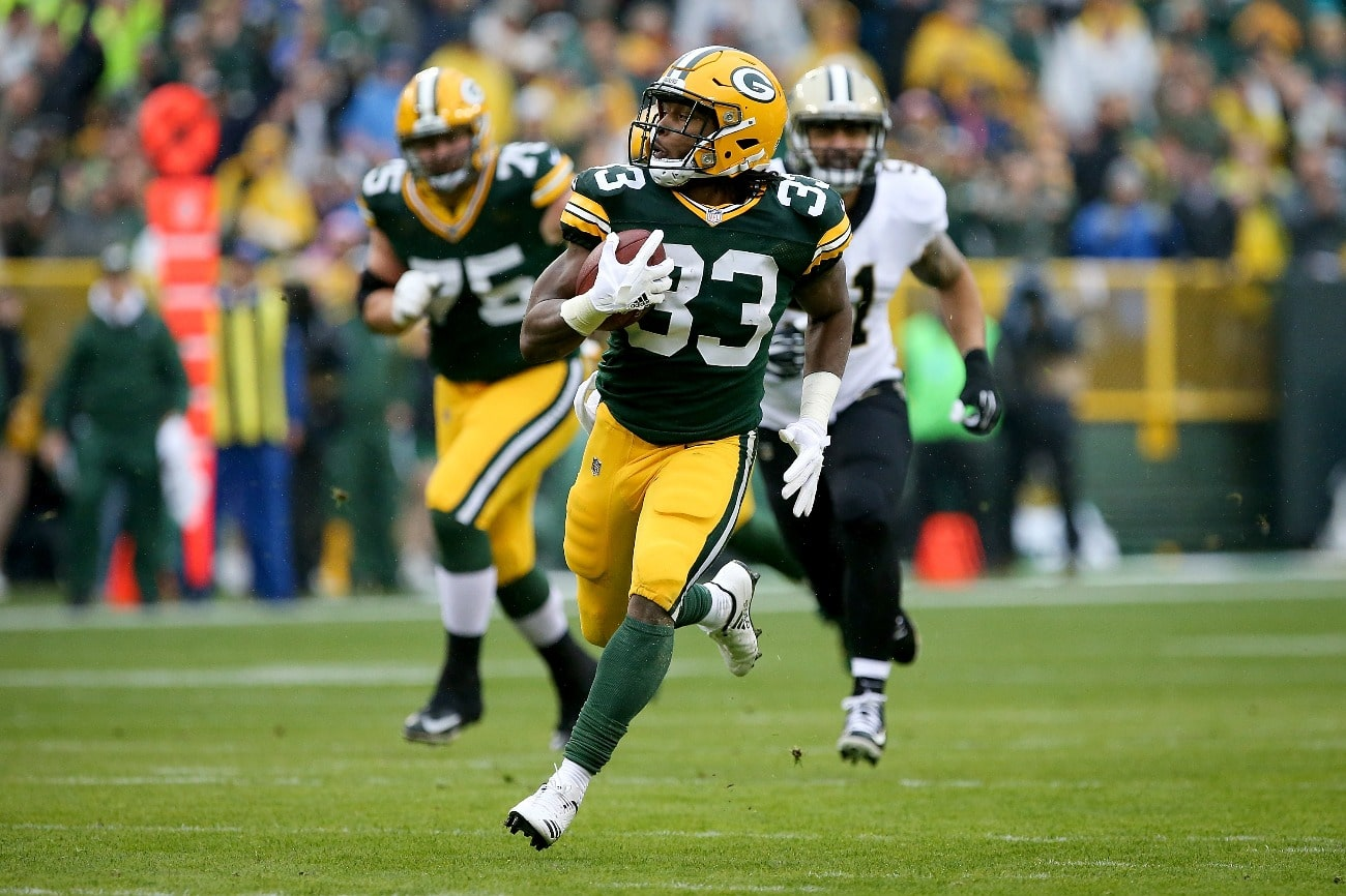 Aaron Jones #33 of the Green Bay Packers runs with the ball in the first quarter against the New Orleans Saints at Lambeau Field on October 22, 2017 in Green Bay, Wisconsin.