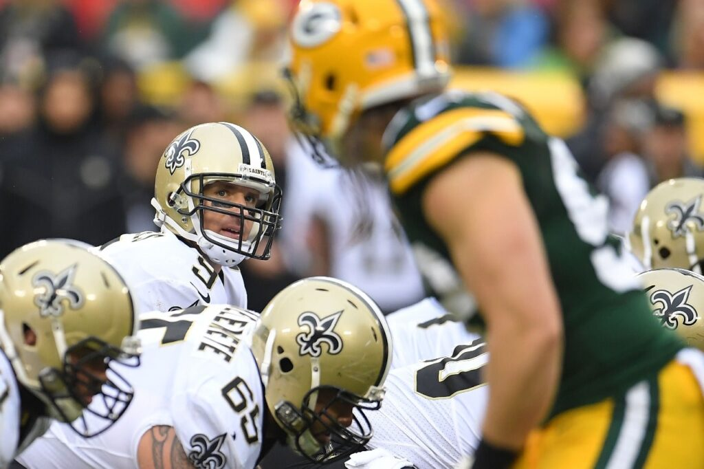 Drew Brees #9 of the New Orleans Saints anticipates a snap during a game against the Green Bay Packers at Lambeau Field on October 22, 2017 in Green Bay, Wisconsin.