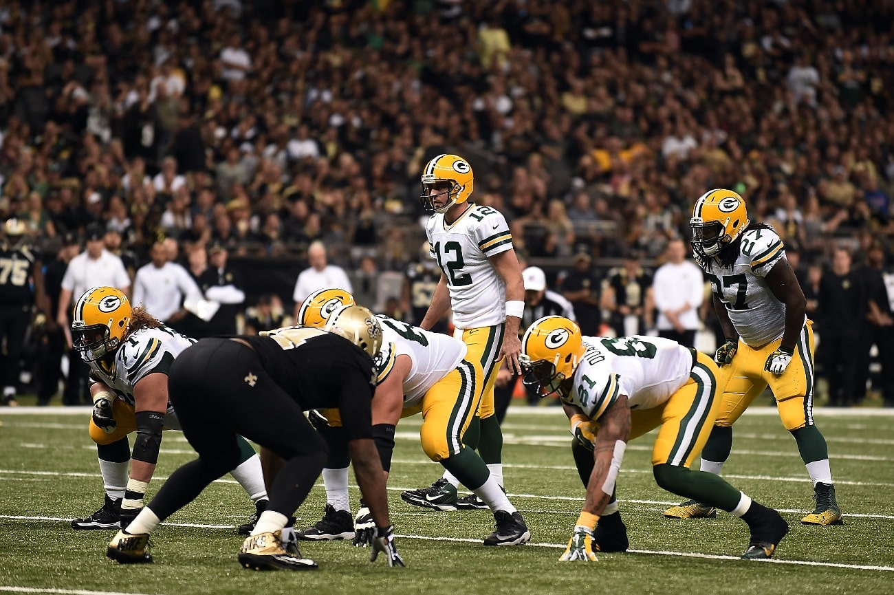 Aaron Rodgers #12 of the Green Bay Packers anticipates a play against the New Orleans Saints during the third quarter of a game at Mercedes-Benz Superdome on October 26, 2014 in New Orleans, Louisiana.
