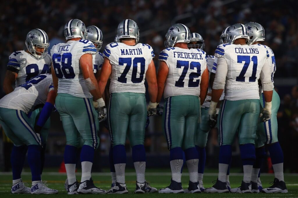 The Dallas Cowboys offense huddles during play against the Seattle Seahawks at AT&T Stadium on November 1, 2015 in Arlington, Texas.