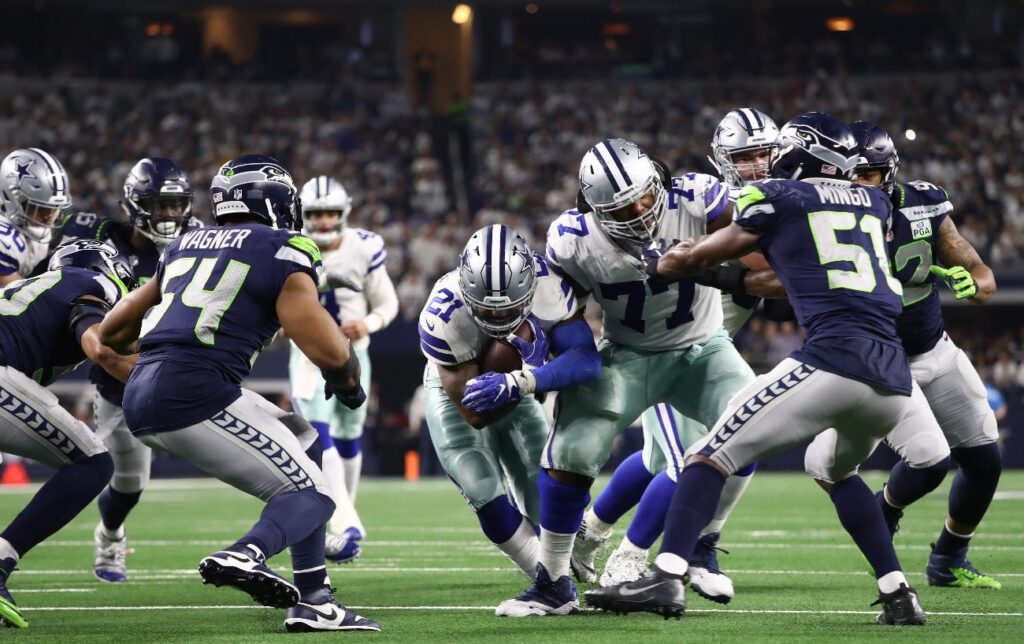 Ezekiel Elliott #21 of the Dallas Cowboys runs the ball against the Seattle Seahawks in the Wild Card Round at AT&T Stadium on January 05, 2019 in Arlington, Texas.
