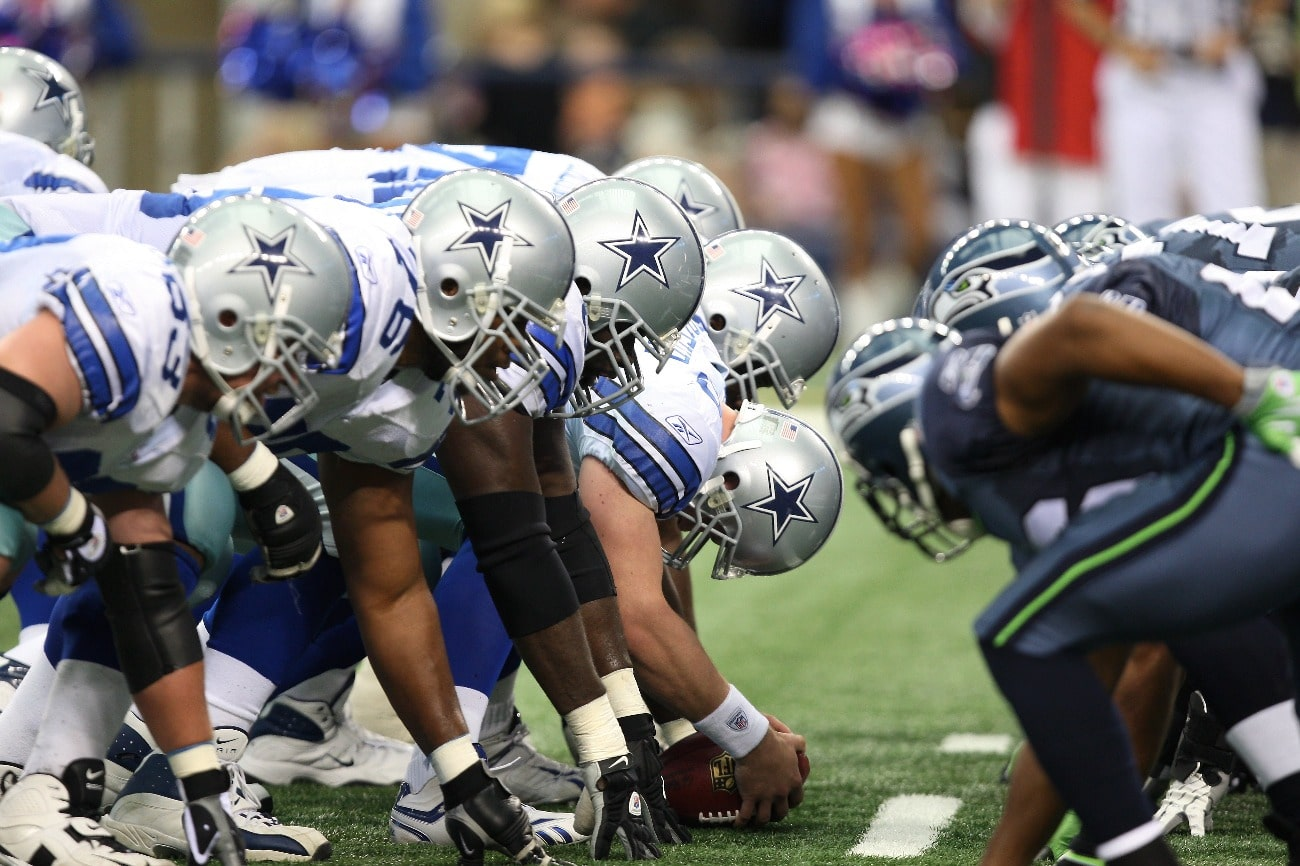 Members of the Dallas Cowboys line up at the line of scrimmage for a kick against the Seattle Seahawks at Cowboys Stadium on November 1, 2009 in Arlington, Texas