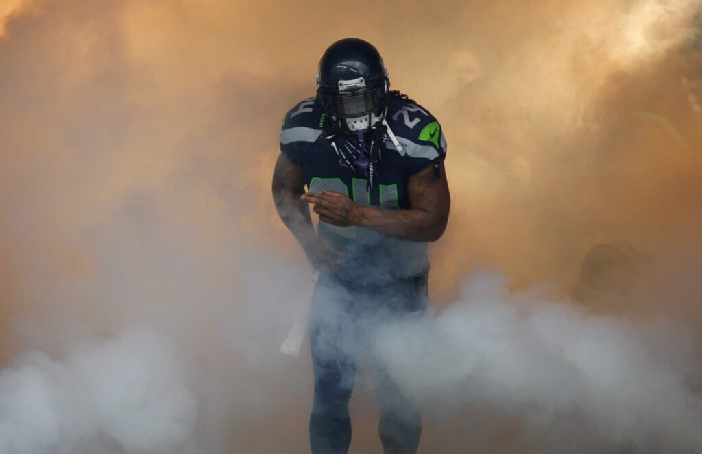 Marshawn Lynch #24 of the Seattle Seahawks is introduced against the St. Louis Rams at CenturyLink Field on December 30, 2012 in Seattle, Washington.